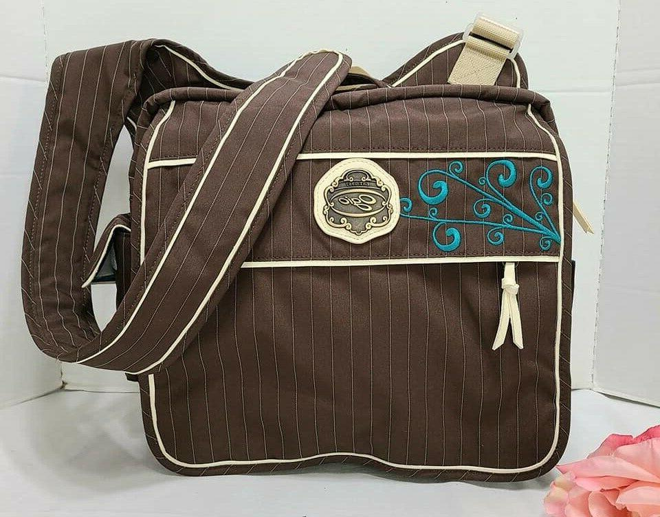 OGIO ROAD TRIP BROWN PIN STRIP & QUILTED TEAL BACK CROSSBODY
